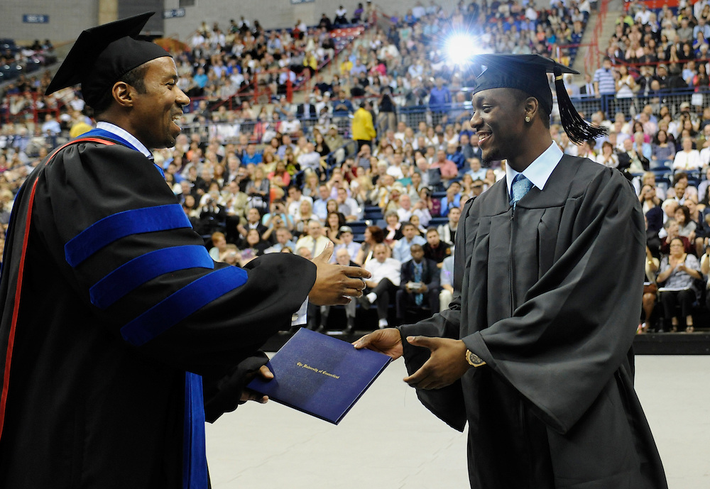 Connecticut men's basketball player Kemba Walker, right, receives his degree from Associate Dean of the College of Liberal Arts and Sciences Jeffrey O.G. Ogbar, left, during University of Connecticut's commencement ceremony in Storrs, Conn., Sunday, May 8, 2011.  (AP Photo/Jessica Hill)