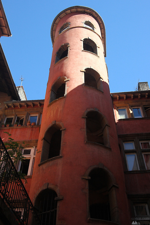 An imposing pink tower in Vieux Lyon (Lyon Old Town), in one of the many Traboules (alleyways); this one is now a boutique hotel - La Tour Rose