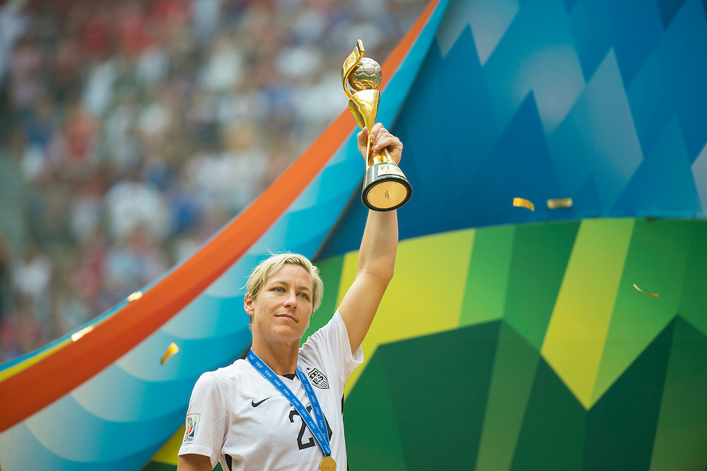 Abby Wambach of team USA holds the World Cup trophy high over her head while celebrating during 2015 women's World Cup Soccer in Vancouver during the final between USA and Japan.