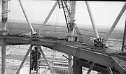 """AMAZING Photo Film discovered Documenting Work In Chernobyl <br />Chernobyl worker Aleksandr Shubovskiy captures rare images <br /><br />During one of the days in 1979-80, when the erection of Ventilation Stack VT-2 common for the third and fourth (not existed at that time) Chernobyl NPP Units was coming to the end, Aleksandr Shubovskiy, who was working within a combined installation crew in a company named """"Spetsenergomontazh"""", arranged with the colleagues a small photo session on his own,They had their pictures taken.<br /><br />The author processed the film and put it on a wardrobe without printing until he had time to print the images. The moment to print the film somehow did not happen, while in February 1986 Aleksandr hit the road for a on a different site in Yakutia. And there he was caught by news about the accident at Chernobyl.<br /><br />A year later, when a Aleksandr  managed to get into his looted flat in the evacuated Pripyat, he discovered an untouched package with films. He brought them home and… forgot for almost 40 years…the printed photographs which no one and never have seen before until now<br /><br />Photo shows: Lifting by a ladder to VT-2.<br />©Aleksandr Shubovskiy/Exclusivepix Media"""