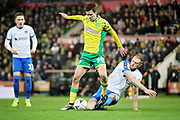 Norwich City midfielder Todd Cantwell (36) is tackled during the The FA Cup 3rd round match between Norwich City and Portsmouth at Carrow Road, Norwich, England on 5 January 2019.