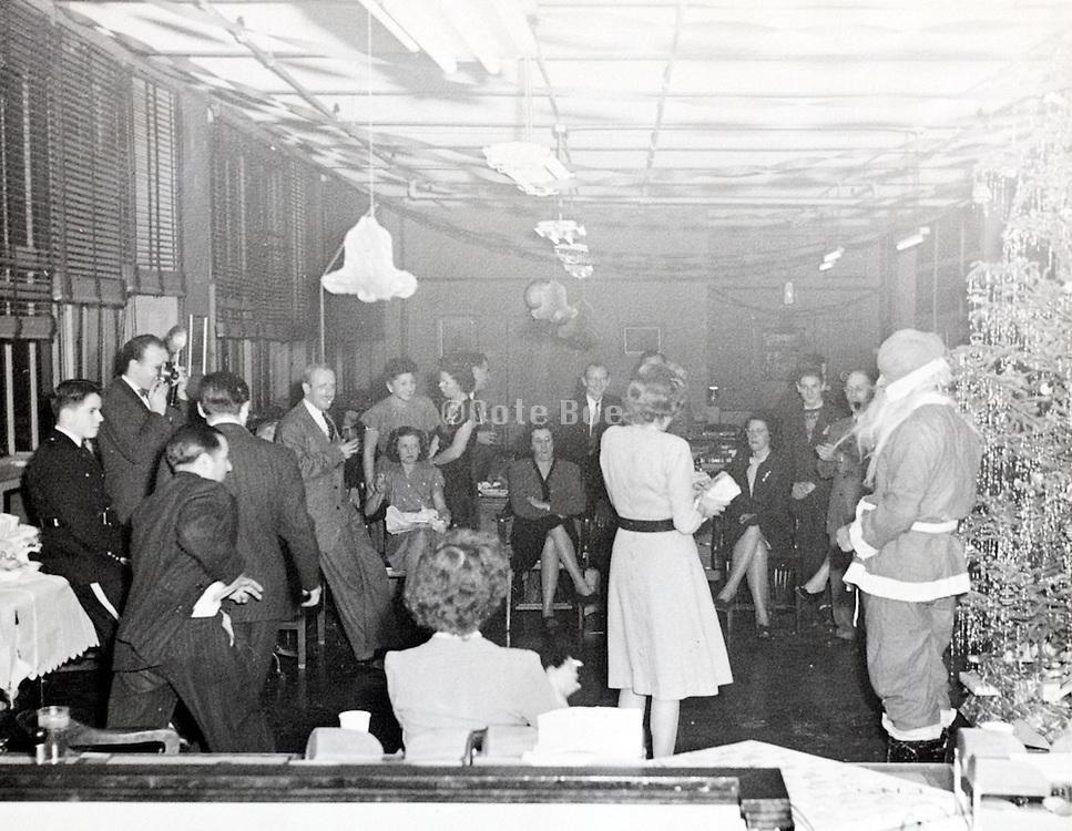 celebrating Christmas at company office USA 1946