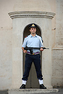 An armed security guard stands at attention while stationed outside the Presidential Palace in Rome, Italy. (Photo by Phelan M. Ebenhack)