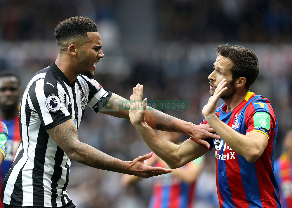 Newcastle United's Jamaal Lascelles (left) speaks with Crystal Palace's Yohan Cabaye during the Premier League match at St James' Park, Newcastle.