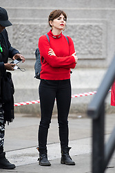 © Licensed to London News Pictures. 10/03/2018. London, UK. OPHELIA LOVIBOND takes part in the 'Million Women Rise' march through central London, campaigning against domestic violence against women. Organisers have asked participants to wear red for the demonstration. On Thursday (8 March) this week, International Women's Day was celebrated. Photo credit : Tom Nicholson/LNP
