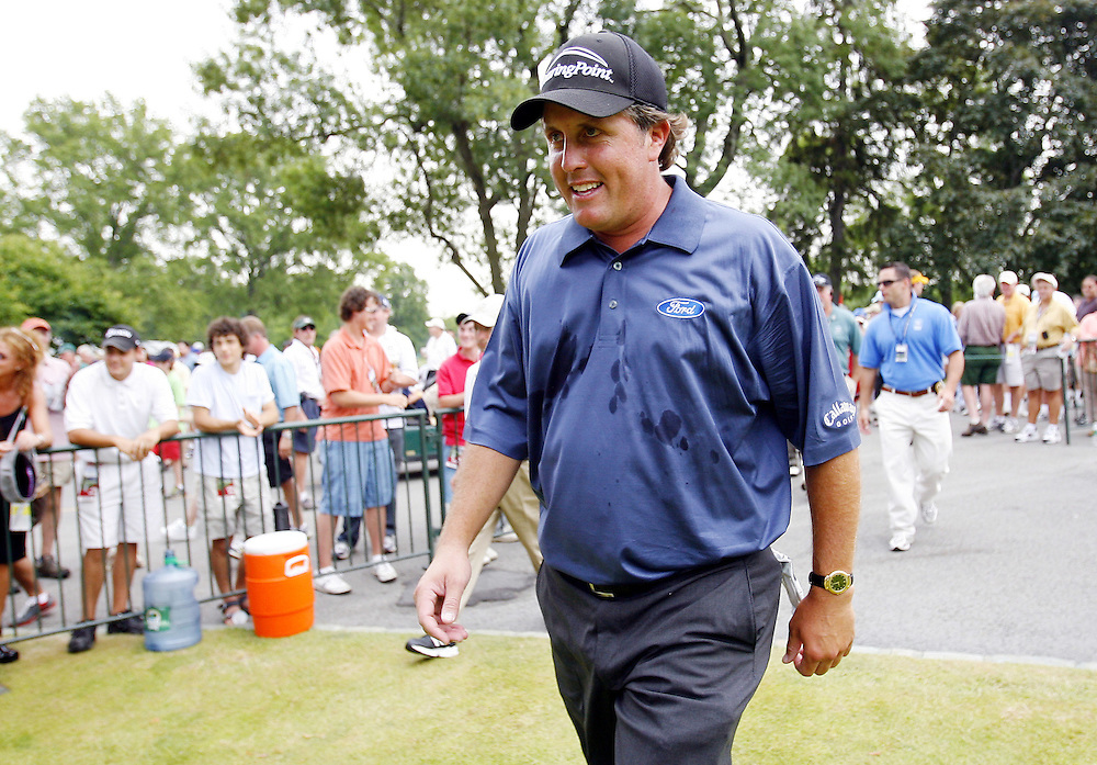 Phil Mickelson of the US makes his way out to the first tee during the third day of the US Open Golf Championship at Winged Foot Golf Club in Mamaroneck, New York Saturday, 17 June 2006. .