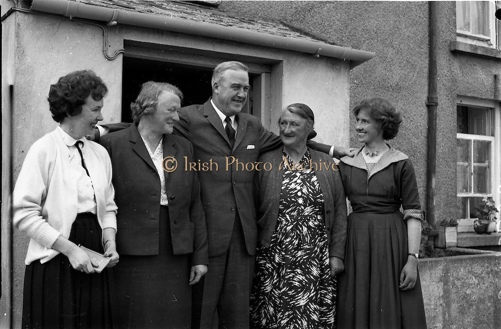 18/05/1961<br /> 05/18/1961<br /> 18 May 1961<br /> U.S. Ambassador Edward Grant Stockdale visits relatives of President John F. Kennedy at Dunganstown, Co. Wexford. The ambassador with the relatives.