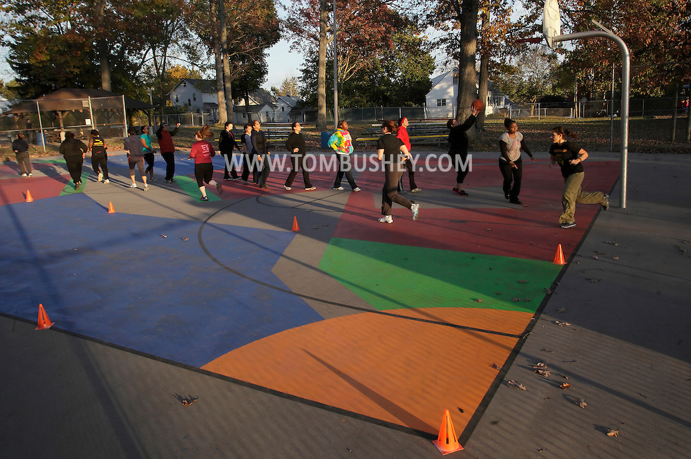 Middletown, New York  - People exercise on a park basketball court during a Boot Camp class on Oct. 23, 2011.
