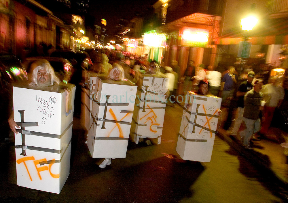 31 October, 2005. New Orleans, Louisiana. <br /> Halloween, post Katrina, New Orleans. As the city returns to a strange sense of normalcy and the citizens return, New Orleans once again hosts a Halloween parade and party. The parade makes its way down Bourbon Street with participants dressed as refrigerators.  <br /> Photo; &copy;Charlie Varley/varleypix.com