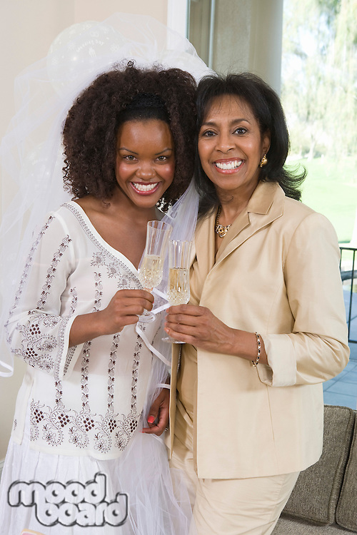 Bride with mother celebrating at bridal shower