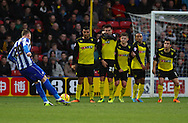Picture by David Horn/Focus Images Ltd +44 7545 970036<br /> 14/12/2013<br /> Connor Wickham of Sheffield Wednesday scores the opening goal during the Sky Bet Championship match at Vicarage Road, Watford.