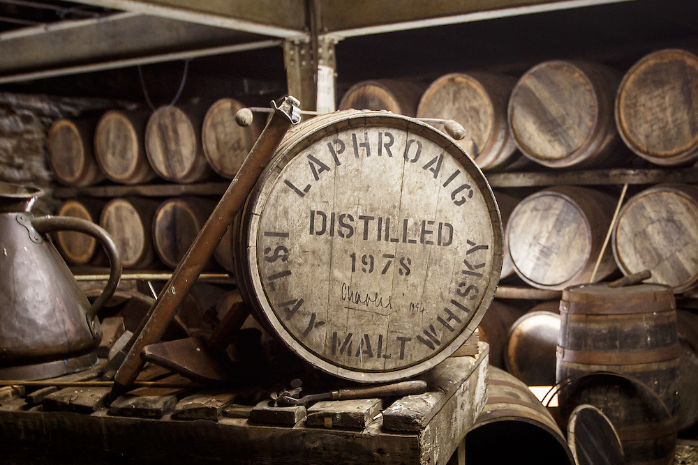 A barrel signed by HRH The Prince of Wales to commemorate his first visit and awarding of the royal warrant to the distillery sits in the bond warehouse at Laphroaig Distillery at Port Ellen, Isle of Islay, Scotland, July 17, 2015. Gary He/DRAMBOX MEDIA LIBRARY