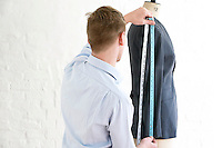 Tailor measuring jacket sleeve back view