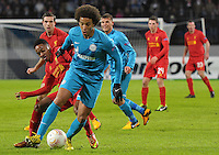 Thu., Feb. 14, 2013, Russia, St. Petersburg. .Zenit St. Petersburg's Axel Witsel, against Raheem Sterling, left, in the UEFA Europa League's last 32 match..Kommersant Photo/Alexander Petrosyan