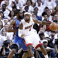 19 June 2012: Miami Heat small forward LeBron James (6) posts up Oklahoma City Thunder guard James Harden (13) during the first quarter of Game 4 of the 2012 NBA Finals, Thunder at Heat, at the AmericanAirlinesArena, Miami, Florida, USA.