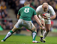 Picture by Paul Terry/Focus Images Ltd. 07545642257.17/03/12.Dan Cole of England looks to move past Jamie Heaslip of Ireland during the RBS Six nations match at Twickenham stadium, London.