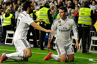 Real Madrid´s James Rodriguez and Alvaro Arbeloa celebrate a goal during 2014-15 La Liga match between Real Madrid and Malaga at Santiago Bernabeu stadium in Madrid, Spain. April 18, 2015. (ALTERPHOTOS/Luis Fernandez)