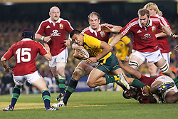© Licensed to London News Pictures. 29/6/2013. Israel Folau charges through Lions defence  during the British & Irish Lions 2nd test between Qantas Wallabies Vs British & Irish Lions at Etihad Stadium, Melbourne, Australia. Photo credit : Asanka Brendon Ratnayake/LNP