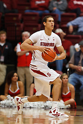 Nov 28, 2011; Stanford CA, USA;  Stanford Cardinal forward Dwight Powell (33) holds the ball against the Pacific Tigers during the first half at Maples Pavilion. Stanford defeated Pacific 79-37. Mandatory Credit: Jason O. Watson-US PRESSWIRE