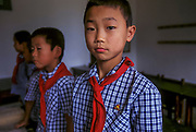 Schoolboys stand to attention, Hangwae Province, North Korea.
