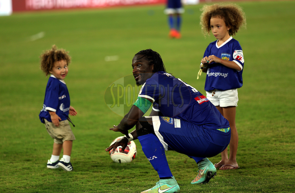 Bernard Mendy of Chennaiyin FC playing with kids of  Mikael Silvestre of Chennaiyin FC after the match 50 of the Hero Indian Super League between Chennaiyin FC and FC Goa held at the Jawaharlal Nehru Stadium, Chennai, India on the 5th December 2014.<br /> <br /> Photo by:  Sandeep Shetty/ ISL/ SPORTZPICS