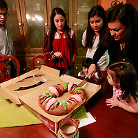 Thomas Wells | BUY AT PHOTOS.DJOURNAL.COM<br /> The Ascota family, Cristian, 19, from left, Luz Elena, 16, Alejandra, Luis, 3, Maria and Daniela, 18 months, begin to cut into their Rosca De Reyes at their home in Tupelo.