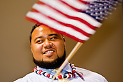 "July 2 - PHOENIX, AZ: Arizona Cardinals' offensive lineman TAITUSI ""Duece"" LATUI,   originally from Tonga, waves an American flag while he is sworn as a US citizen Friday. Nearly 200 people were sworn in as US citizens during the ""Fiesta of Independence"" at South Mountain Community College in Phoenix, AZ, Friday. The ceremony is an annual event on th 4th of July weekend and usually the largest naturalization ceremony of the year in the Phoenix area.  Photo by Jack Kurtz"