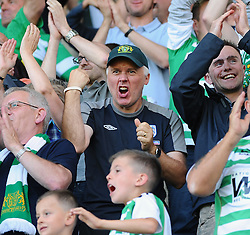 Yeovil fans celebrate their sides victory - Photo mandatory by-line: Seb Daly/JMP - Tel: Mobile: 07966 386802 03/08/2013 - SPORT - FOOTBALL - The Den - Millwall -  Millwall V Yeovil Town - Sky Bet Championship