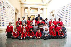 © Licensed to London News Pictures. 11/11/2019. London, UK. School children from Tyssen Community School in Hackney pose for photograph with Turner Prize-winning artist and Oscar-winning filmmaker Steve McQueen during the preview of 'Steve McQueen Year 3' exhibition at Tate Britain. An installation of over 3,000 class photographs lining the walls of Tate Britain's Duveen Galleries, depicting more than 70,000 Year 3 pupils from London's primary schools. The exhibition opens on 12 November until 3 May 2020. Photo credit: Dinendra Haria/LNP