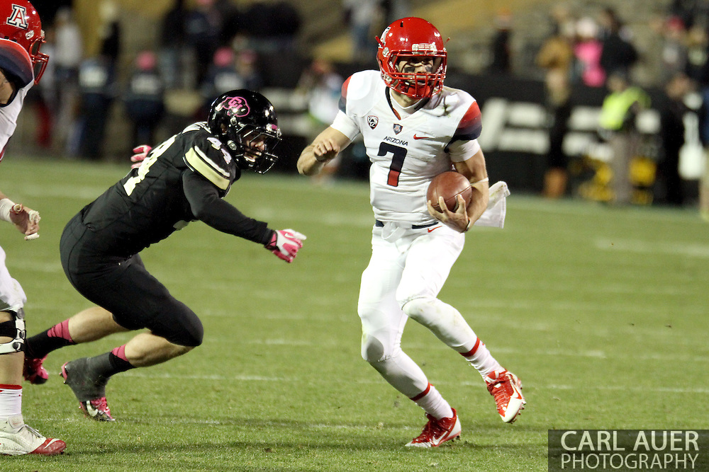 October 26th, 2013:  University of Arizona Wildcats senior quarterback B.J. Denker (7) scrambles with the ball in the fourth quarter of the NCAA football game between the University of Arizona Wildcats and the University of Colorado Buffaloes at Folsom Field in Boulder, Colorado