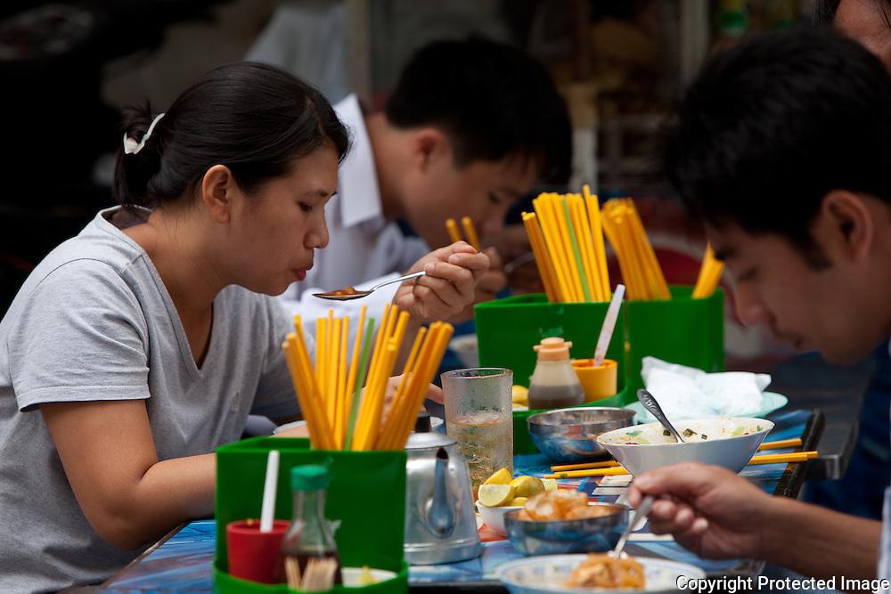 diners at Sang Banh Ho chi minh city noodle shop, vietnam