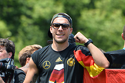 15.07.2014, Brandenburger Tor, Berlin, GER, FIFA WM, Empfang der Weltmeister in Deutschland, Finale, im Bild Lukas Podolski (GER) // during Celebration of Team Germany for Champion of the FIFA Worldcup Brazil 2014 at the Brandenburger Tor in Berlin, Germany on 2014/07/15. EXPA Pictures © 2014, PhotoCredit: EXPA/ Eibner-Pressefoto/ Harzer  *****ATTENTION - OUT of GER*****