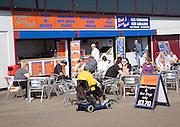 People sitting outside cafes Bridlington, Yorkshire, England