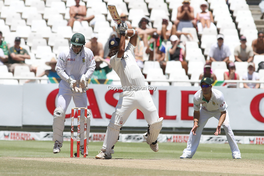 CAPE TOWN, SOUTH AFRICA - 6 January 2011, Rahul Dravid of India plays a delivery off the back foot as Mark Boucher of South Africa and AB de Villiers of South Africa look on during day 5 of the 3rd Castle Test between South Africa and India held at Sahara Park Newlands Stadium in Cape Town, South Africa on the 6 January 2011 .Photo by: Shaun Roy