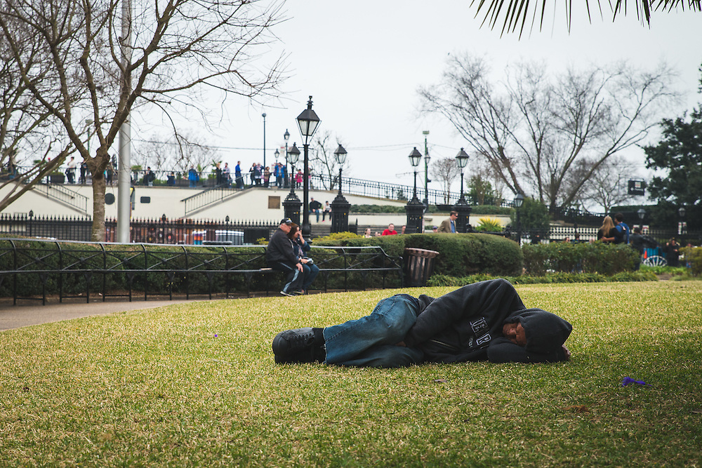 Catching some sleep after a long night in the French Quarter.<br /> Jackson Square<br /> French Quarter<br /> New Orleans, LA