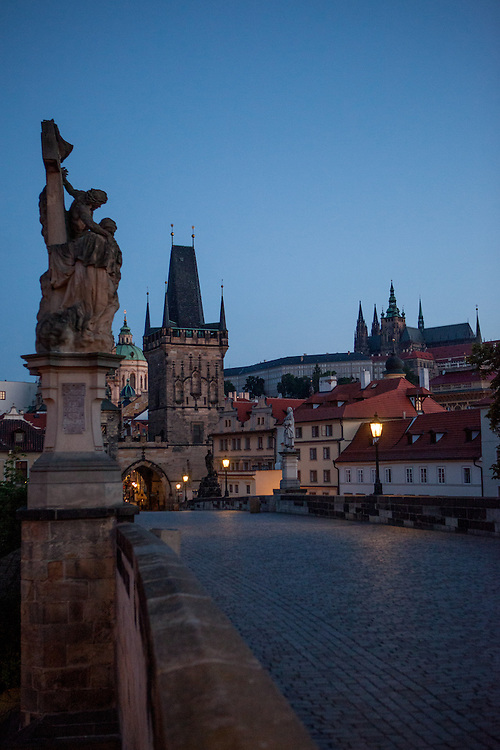 Charles Bridge and the view to Lesser Town (Mala Strana) during the early morning change from night to day.