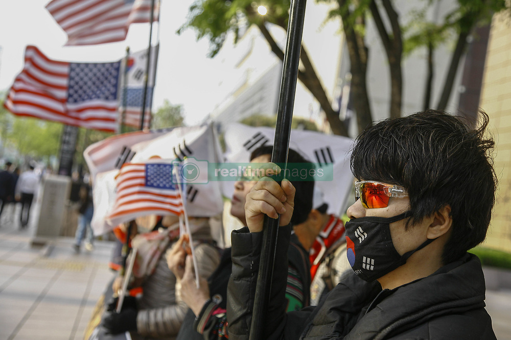 April 26, 2018 - Seoul, SOUTH KOREA - A South Korean conservative protester holds a flag during a rally against Inter Korean Summit in downtown in Seoul, South Korea. The summit between South Korean President Moon Jae-in and North Korea's leader Kim Jong-un is scheduled on April 27, 2018 at the Joint Security Area in Panmunjom. (Credit Image: © Ryu Seung-Il via ZUMA Wire)