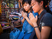 19 AUGUST 2015 - BANGKOK, THAILAND: Malaysians who lost family members in the terror bombing of Erawan Shrine pray during a memorial service at the shrine's reopening. Erawan Shrine in Bangkok reopened Wednesday morning after more than 20 people were killed and more than 100 injured in a bombing at the shrine Monday, August 17, 2015. The shrine is a popular tourist attraction in the center of Bangkok's high end shopping district and is an important religious site for Thais. No one has claimed responsibility for the bombing.        PHOTO BY JACK KURTZ