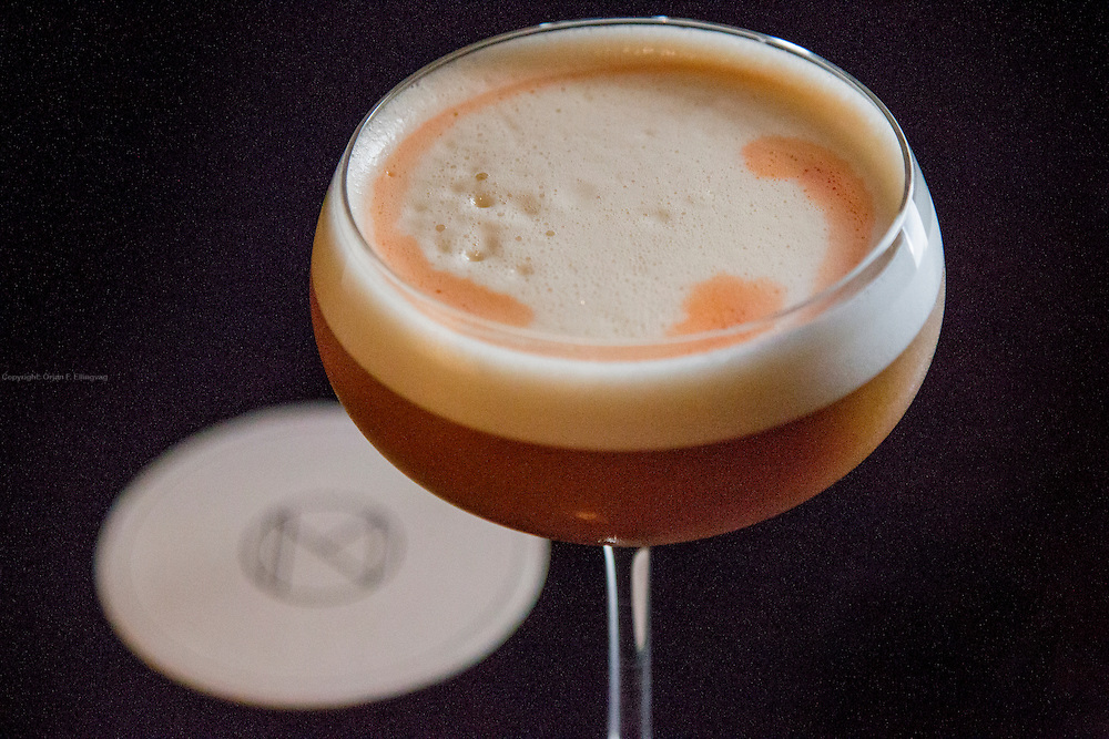 A Cafe con Leche cocktail made by Bartender-in-Chief at the Nomad on Manhattan, Leo Robitschek. Strikingly similar to the coffe drink visually, this cocktail is made of rum, egg whites and aquavit, garnished with a dash curacao.
