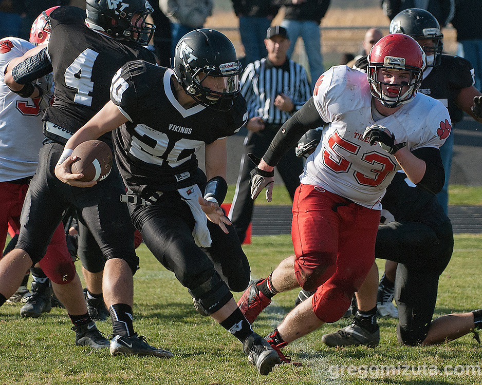 Vale junior running back Lane Cummings avoids Clatskanie's Mica Karber during the round 1 playoff game, November 9, 2013 at Frank Hawley Stadium Vale High School, Vale, Oregon. Vale won 46-0 to advance to the quarterfinals.