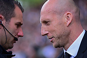 Reading first team manager Jaap Stam has a word with referee Mr Attwell during the EFL Sky Bet Championship play off first leg match between Fulham and Reading at Craven Cottage, London, England on 13 May 2017. Photo by Jon Bromley.
