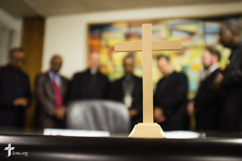 A delegation from The Lutheran Church–Missouri Synod and the Ethiopian Evangelical Church Mekane Yesus, pray together after signing a working-partnership agreement at the EECMY Central Office on Thursday, Nov. 13, 2014, in Addis Ababa, Ethiopia.   LCMS Communications/Erik M. Lunsford