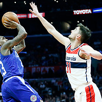 09 December 2017: LA Clippers guard Lou Williams (23) takes a jump shot over Washington Wizards guard Tomas Satoransky (31) during the LA Clippers 113-112 victory over the Washington Wizards, at the Staples Center, Los Angeles, California, USA.