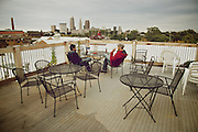 Anuj Anujansal, left, and Jakob Schneider, right, of Chicago on the roof of the  Cleveland Hostel on Thursday, Sept. 27, 2012.