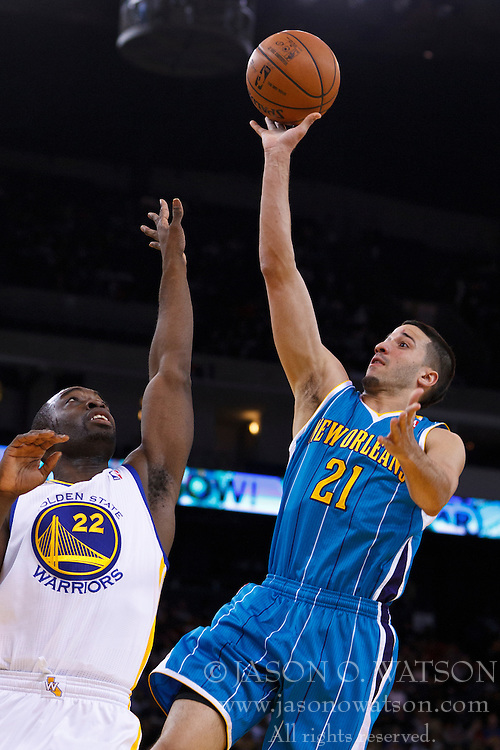 Mar 28, 2012; Oakland, CA, USA;  New Orleans Hornets point guard Greivis Vasquez (21) shoots over Golden State Warriors guard Charles Jenkins (22) during the second quarter at Oracle Arena. Mandatory Credit: Jason O. Watson-US PRESSWIRE