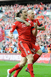 Andy Carroll of Liverpool (left) celebrates scoring the winning goal with team mate Martin Skrtel during the Budweiser FA Cup semi final match between Liverpool and Everton at Wembley on Saturday 14 April 2012 (Photo by Rob Munro)