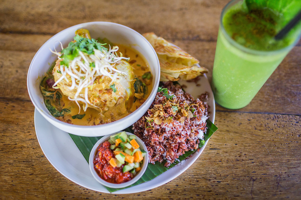 Red chicken coconut curry with a power smoothie at Betelnut Cafe.