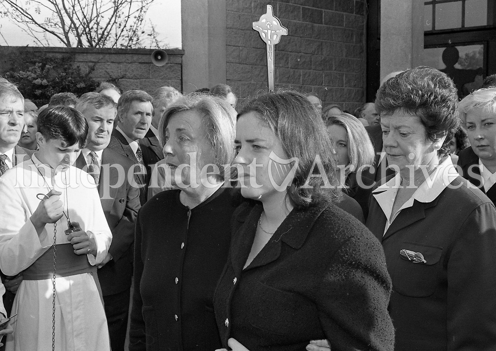 Mrs Anne Lenihan with her daughter Anita Lenihan and Mrs Mary O'Rourke sister of Brian Lenihan leaving Our Lady's Church after the Funeral Mass, Castleknock, Dublin, circa November 1995 (Part of the Independent Newspapers Ireland/NLI Collection).