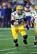 Green Bay Packers tackle Bryan Bulaga (75) run blocks during the NFL NFC Divisional round playoff football game against the Arizona Cardinals on Saturday, Jan. 16, 2016 in Glendale, Ariz. The Cardinals won the game in overtime 26-20. (©Paul Anthony Spinelli)