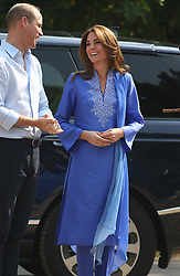 The Duke and Duchess of Cambridge arrive for a visit to a government-run school in central Islamabad on day two of the royal visit to Pakistan.